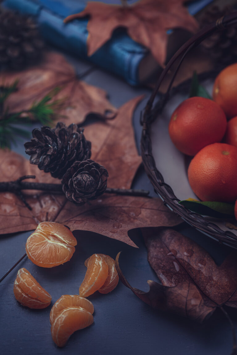 Autumn still life photography with mandarins and leaves