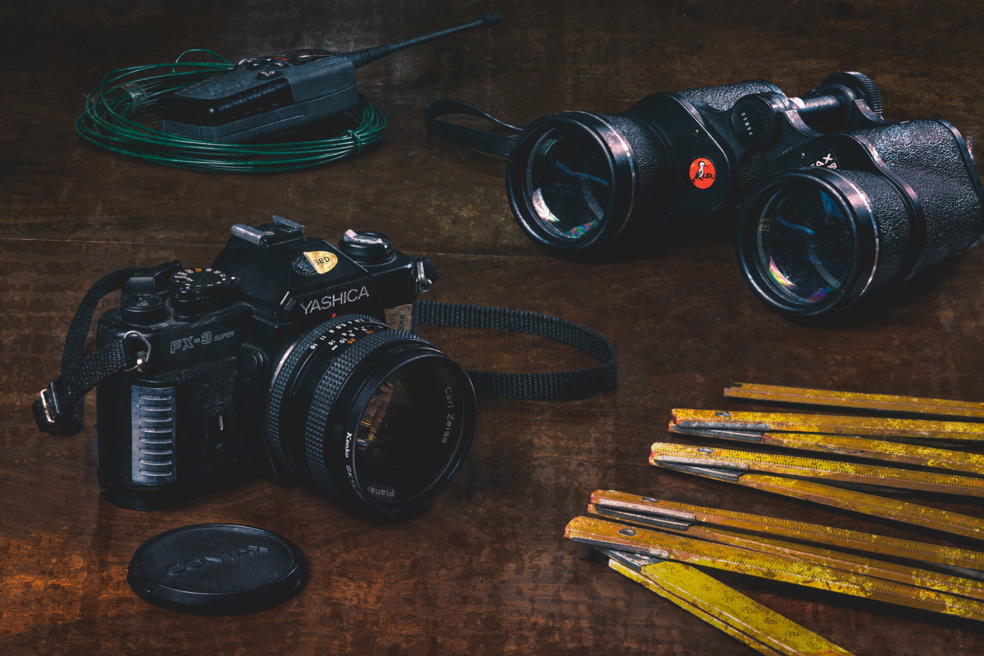 still life, film camera, binoculars, radio