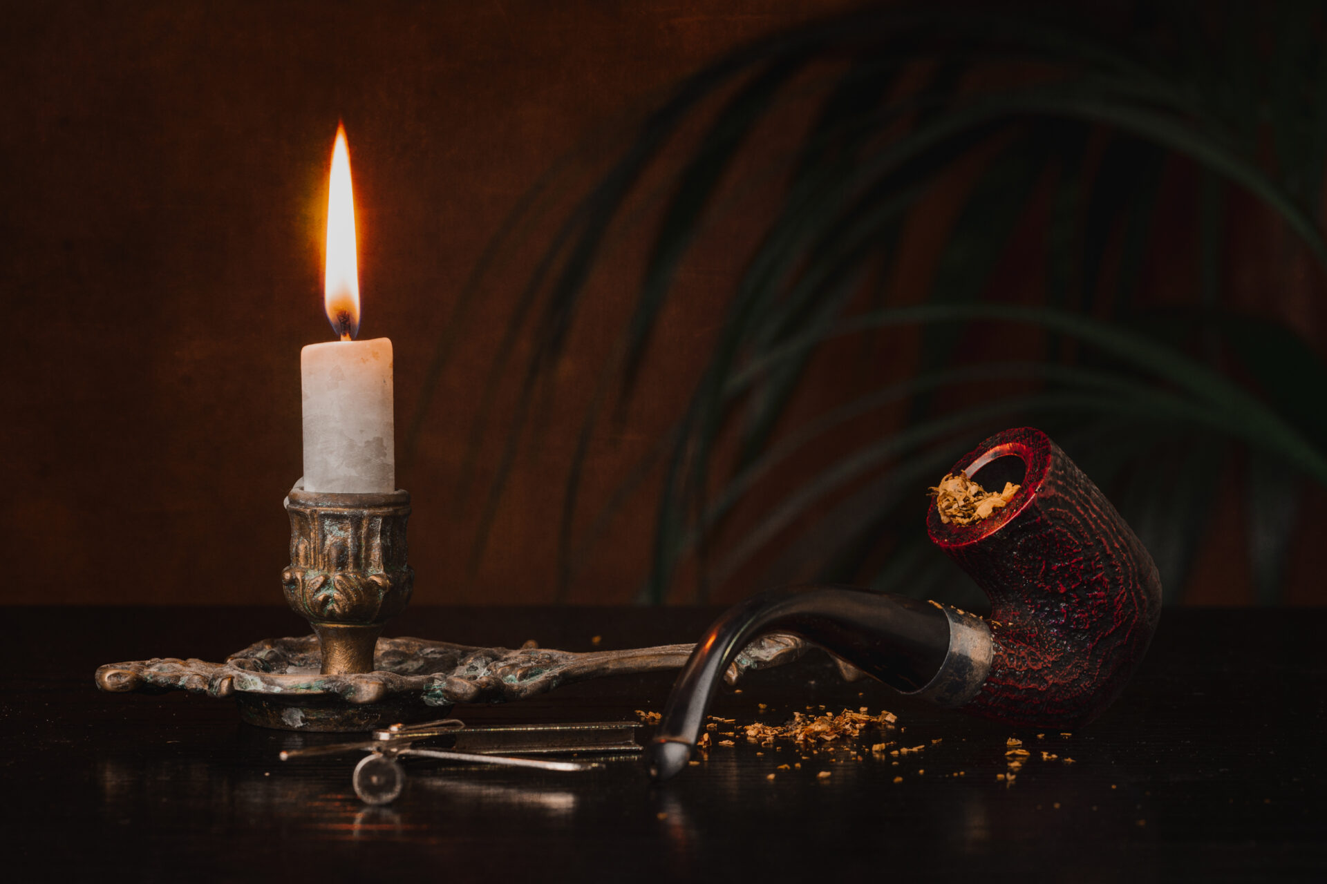 still life photo of pipe and candle