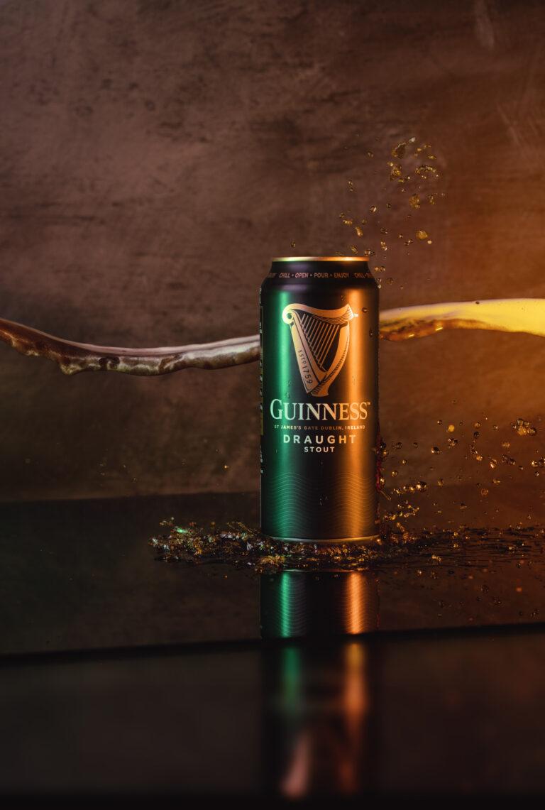 guinness can splash beer